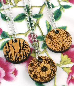 Amy Bengston laser cut bamboo pendants with silver plated steel chains.