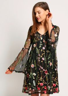 Black embroidered shift dress with v-neckline and back, long bell sleeves. Partially lined, semi sheer sleeves.