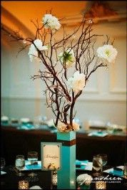 branch centerpiece: collect twigs/branches on nature walks, then spray paint them. After arranged in vase you can use jewlery wire to attach flowers or hang stuff from them