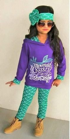 From school to the playground your little fashionista will be center of attention in this adorable Mermaid Kisses 3 piece set. Includes hoodie top, leggings and matching headband. Available in sizes 2T-6 All Items are cotton blend material Order up a size for longer wear time frame Wash Cold