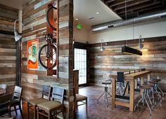 I love the look of this reclaimed boards on the walls.  I think we could put some walls up and cover them with this.  And if not like this...some type of same treatment would be something to consider.