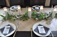 Rustic Casual Tablescape: brown kraft paper, white candles, herbs and antlers come together to make a beautiful rustic and casual table.