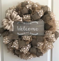 A great farmhouse style wreath! This wreath is done in burlap deco mesh with a houndstooth print and white polka dot print ribbon. Centered with a stenciled wood welcome sign. Two sizes available. 22 or 25 inch Deco Mesh Wreaths, Easter Wreaths, Holiday Wreaths, Rustic Wreaths, Burlap Wreaths, Floral Wreaths, Country Wreaths, Fall Crafts, Christmas Crafts