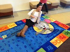 """Age of Learning staff member """"tests out"""" on of our new ABCmouse.com branded rugs. Great for classrooms and playrooms. More at https://www.flickr.com/photos/ageoflearning/"""