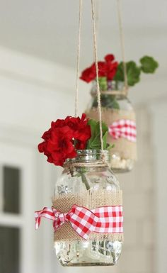 Geraniums in mason jars hung from the ceiling