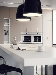 Kitchen Design with Wooden White Table and Black Chic Pendant Lights and Black Chairs also Cute Bookcase and Cabinets