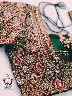 Crafted in gold & accentuated with dazzling diamonds and radiant emeralds, this stunning piece from our bridal collection is perfect to… Cotton Saree Blouse Designs, Wedding Saree Blouse Designs, Wedding Blouses, Blouse Patterns, Stone Work Blouse, Indian Embroidery, Bridal Collection, Engagement Gowns, Maggam Works