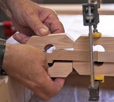 Clamp blocks force the boards to align perfectly for gluing up wide panels of solid wood