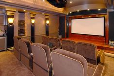 The home theater feels like a mini Radio City, with art deco touches and plush seats. Andy Chen of Pacific Audio/Visual built a 10,000-watt audio/video system wired so that you can actually feel the sound in the seats. Supersonic!