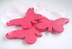 "A set of three fuschia pink butterflies, hand-painted with added sparkle so that they glisten in the light.    Each one measures approx. 3.75"" (9.5 cm) at it's widest point, is 2.5"" high (6.4 cm) and 1/8"" thick.     Check out our bright and sassy home decor items at www.CreativeHomeDecorations.com"