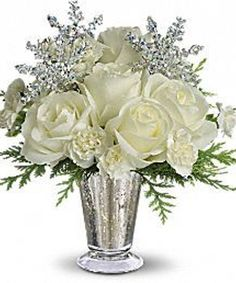 Winter Glow Bouquet As enchanting as falling snowflakes, this dramatic yet graceful arrangement is a beautiful choice for an elegant evening celebration, winter ball centerpiece or to send silver anniversary wishes during the winter months. Winter Flower Arrangements, Christmas Arrangements, Christmas Centerpieces, Floral Arrangements, Christmas Decorations, Table Arrangements, Rose Centerpieces, Stage Decorations, Centrepieces