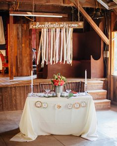ribbon garland over sweetheart table
