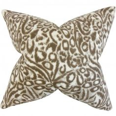 Add a quirky touch to your interiors with this accent pillow. This throw pillow features a graphic pattern in shades of brown and white. It ensures long lasting comfort to your living room or bedroom. Made of 100% plush cotton fabric. Crafted in the USA. $55.00 #pillows #homedecor #tosspillow #graphic
