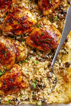 Easy Oven Baked Chicken And Rice With Garlic Butter Mushrooms mixed through is winner of a chicken dinner! Mouthwatering baked chicken thighs coated in a beautiful rub, baked on top of fluffy soft rice... all