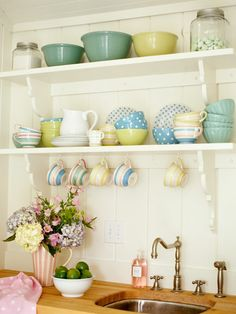 Pastels and open shelves so that you can see the china. Pretty