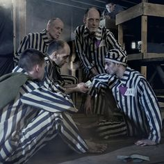 Jehovah's Witnesses in a Nazi prison camp reading together
