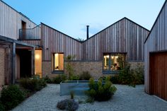 """Charlie Luxton Design decided to """"refurbish not demolish"""" a neglected brick bungalow on the edge of a village in the Cotswolds, to create a family home. Renovation Facade, Bungalow Renovation, Wooden Trellis, South Facing Garden, Front Courtyard, Small Courtyards, Rural Retreats, Roof Structure, Ranch Style"""