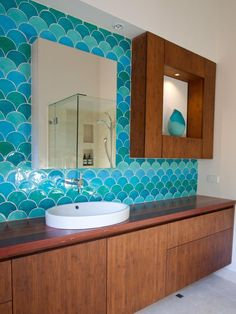 Designer Camilla Molders used five different colorways in these fish scale tiles. From HGTV's Favorite Bright, Bold Bathrooms. Please note this image may be copyrighted and any redistribution outside Pinterest may result in legal action. This is NOT a Parrish Construction project. Pin/re-pin is intended ONLY to serve as inspiration for friends of Parrish.