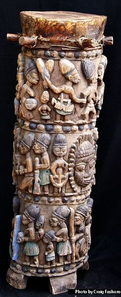 A superbly populated Ogboni cult ritual drum by George Bamidele Areogun. Between 1940 - 42, the Ogboni cult commissioned Bamidele to carve ritual implements, especially ritual drums, for the cult's Iposi, Ekiti compound.