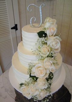 Butter Cream Frosted Wedding Cake With Fresh Flower Cascade
