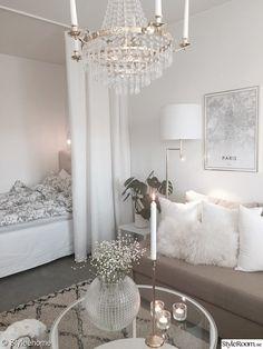 Studio apartment in neutral colors.