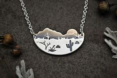 Desert Sun Necklace - Silver and Gold Metalwork - Arizona Cactus Landscape Pendant - Contemporary Southwestern Jewelry - Mixed Metal by GatherAndFlow on Etsy https://www.etsy.com/listing/272165488/desert-sun-necklace-silver-and-gold