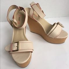 """Cream Wedge Platform Sandal Just Fab New These sandals are a size 10 new without box.  There are a cream color with red accents. The heel is 5"""" inches.  NO TRADES!                         I accept reasonable offers! JustFab Shoes Platforms"""