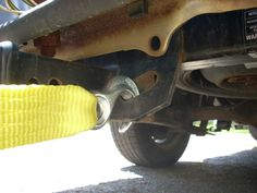How to Use Tow Straps, Hooks and Cables to Tow a Car: Attaching The Hook To The Pulling Vehicle