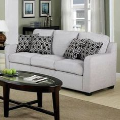 Light grey sofa with chenille upholstery and coordinating accent pillows.   Product: SofaConstruction Material: Chenille and woodColor: Light greyFeatures:  Accent pillows included20 Seat height Dimensions: 37.5 H x 79 W x 35 D
