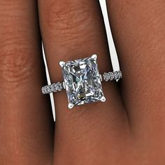 Moissanite engagement ring set with a 3.90 ct radiant cut True Light™ Moissanite, G/H Color. 16 diamonds, .29 ct, G/H SI1 quality. FREH-a
