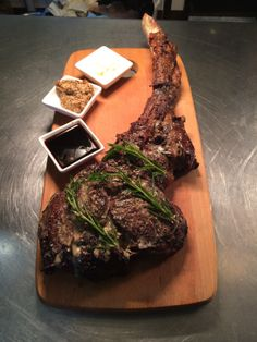 "Our famous Rangers valley ""black Onyx"" tomahawk big boy steak! 1.5kg of 300 day grain feed beef, cooked in our Spanish Josper charcoal oven and served with a selection of mustard's, jus, horseradish, kipflers, green beans and fresh seasonal salad.  www.stillwateratcrittenden.com.au"