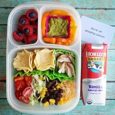 I was inspired do make this build your own nacho/taco bowl lunch for Monkey!   IN THIS LUNCH: Tortilla chips scoops, roasted chicken, tomatoes, lettuce, corn, black beans, shredded cheese, sweet pepper strips, guacamole, and raspberries stuffed with blueberries. To drink we have #organic vanilla milk. packed in @easylunchboxes   #monkeymunchables #packedlunch #schoollunch #kidsbento #americanbento #healthykidsfood #adultbento #healthyfood #easykidslunch