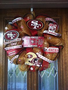 Cheer on your team with this customize Deco Mesh Wreath . Its customize with Gold Deco mesh and red mesh ribbon and to add some fun to 49ers Wreath, Football Wreath, Mesh Ribbon Wreaths, Deco Mesh Wreaths, 49ers Fans, Nfl 49ers, Diy And Crafts, Arts And Crafts, Sports Wreaths