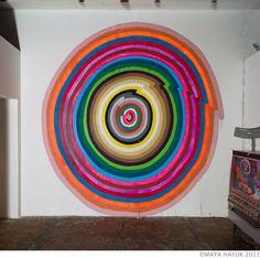 colourful graffiti circle rainbow street art by Maya Hayuk