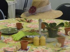 Gardener table  Gardener hat  On table-garden tools, gloves, potted plant  Favor-little clay pot, seeds and little hat