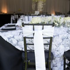 Black chairs with stunning white chair decor, design your perfect day with Grand Event Rentals at www.grandeventrentalswa.com