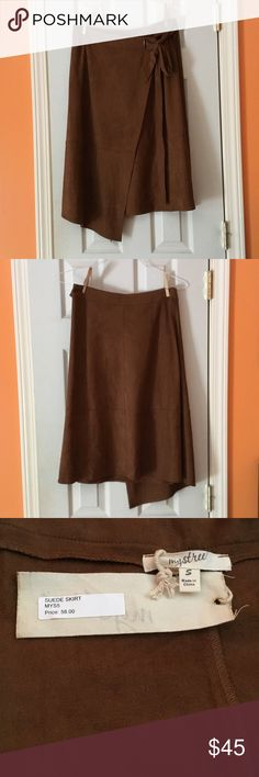 Mystree Sued skirt NWT Mystree sued skirt with asymmetrical hemline. The skirt is a wrap around with a tie sash. Beautiful brown color.  It is to nice to just hang in my closet bought it to wear to a fall wedding and ended wearing something else. Mystree Skirts Asymmetrical