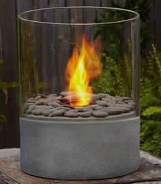 Modesto Fire Column  Price: $95.00     Uploaded by Maria Fe Pierce  I've been wanting to buy a tabletop fire pit for my back porch for some time now. When those summer soirees continue well into the night, just light this baby up and continue the party!