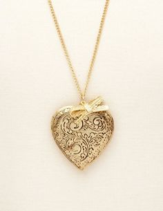 Be given a locket from the man I love, with his picture inside. That way he will always be close to my heart <3