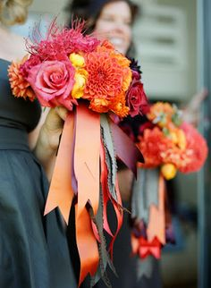 Brilliant and unusual orange bouquet with streams of wide ribbon  | Brooklyn Bride - Modern Wedding Blog #orangebouquet #orangeflowers #orange