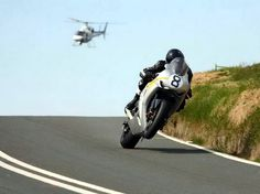 Guy Martin, Isle of Man TT. When these guys top 195 on country roads the helicopters fall away.