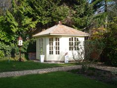 This summerhouse is designed to sit neatly in a corner of the garden.  Finished with a cedar shingle roof.