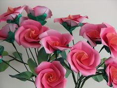 Origami roses, plus pics of many gorgeous paper flowers https://www.flickr.com/photos/dancusa/page1/