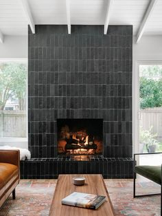 A Shiplap Ceiling Transformed This Dated Home Clay Imports An Austin Tile Company The Couple Went With A Glazed Saltillo Thin Brick Tile In Matte Black Black Fireplace, Home Fireplace, Fireplace Design, Fireplaces, Fireplace Feature Wall, Fireplace Facade, Fireplace Hearth, Fireplace Remodel, Fireplace Surrounds