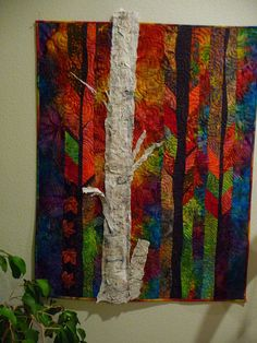 """3D tree.  Lovely backgrounds quilting.  Peggy Holt has a newly released book called """"Dream Feathers"""" that I am anxious to see, too."""