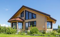 Prefab house / glue-laminated wood / traditional / energy-efficient