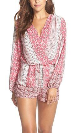 So cute! A surplice neckline and loose-fitting silhouette define this ultra-versatile woven romper.