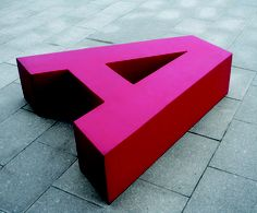 This garden bench is called simply A. That's because of its shape: a replica of the first letter of the alphabet. The A bench was designed by Pieter Garden Furniture, Outdoor Furniture, Giant Letters, Outdoor Seating, Outdoor Decor, Bench Designs, Visual Effects, Simple Designs, Shapes
