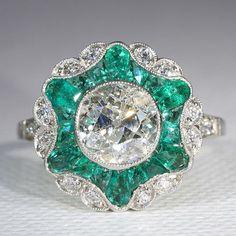 1.7ct center stone diamond & emerald ring, $21800