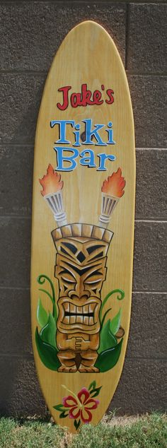 4' Surfboard wall art, Tiki Bar, custom painted, personalized, sign by chesnutdesignsonline on Etsy https://www.etsy.com/listing/108794297/4-surfboard-wall-art-tiki-bar-custom